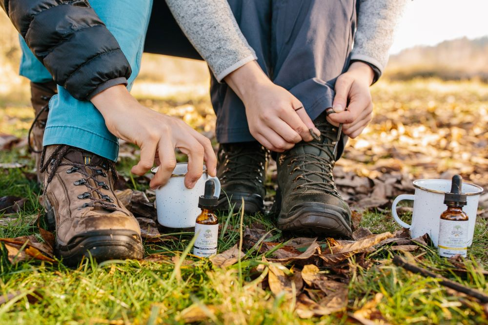 Couple on a hike taking CBD oil